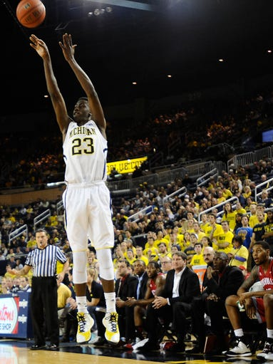 Michigan's Caris LeVert shoots from long range to score