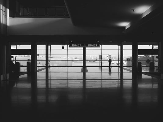 man standing alone in the ben gurion airport