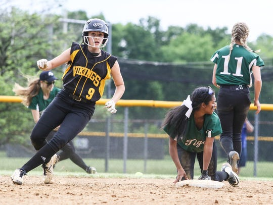 South Brunswick's Jessica Stadler stops at second base