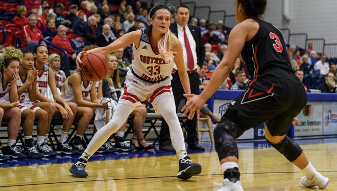 USI's Kaydie Grooms (33) dribbles as she is guarded by Lewis's Kayla Brewer (3) during the fourth quarter at USI's Physical Activities Center in Evansville, Ind., Thursday, Nov. 30, 2017. The Screaming Eagles defeated the Flyers, 67-56.