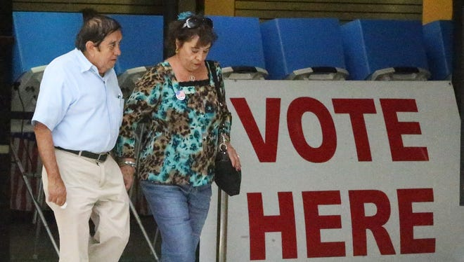 Jose and Monserrat Reyes walk out of the polling location inside Bassett Place.