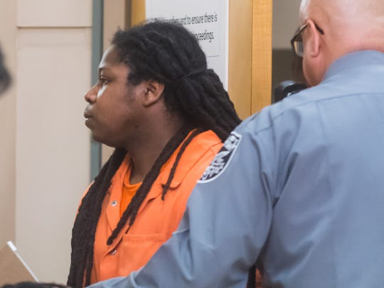 Terrell Savage enters the courtroom for his pre trial