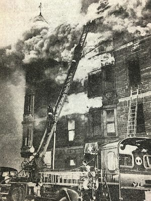 Firemen attempt to put out the Moon Block fire in 1949.
