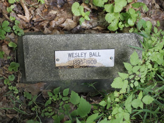 The grave of Wesley Ball in the Industry Residential Center graveyard in Rush.