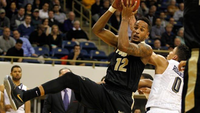 Purdue's Vince Edwardsbattles for a loose ball with Pitt's James Robinson during the game at Petersen Events Center on December 1, 2015 in Pittsburgh, Pennsylvania.