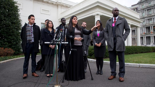 In this Dec. 4, 2014, photo, Lorella Praeli, 26, of New Haven, Conn., originally from Peru, and representing the group United We DREAM, with a group of immigrant youth who were eligible for the president's deferred action, speaks to the media after they met with White House Domestic Policy Director Cecilia Munoz at the White House in Washington. After coming out of the shadows and organizing on their own to advocate for immigration relief, many young immigrants known as dreamers are taking sides with political parties and working or volunteering for presidential campaigns.