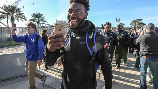 Players arrive at EverBank Field for the TaxSlayer Bowl against Georgia Tech on Saturday morning.