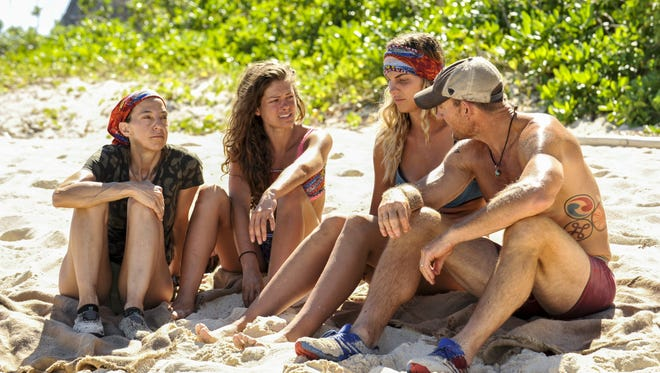 Hali Ford, second from left, joins her Mana teammates Debbie Wanner, left, Sierra Thomas, second from right, and Brad Culpepper.