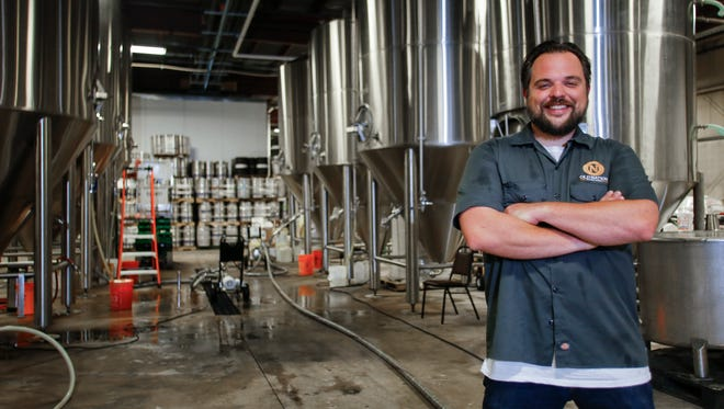Travis Fritts, owner of Old Nation Brewing Co. in Williamston, spent $800,000 to expand his capacity to meet demand for his popular IPA, M-43. The government shutdown may delay the release of the company's Electron Brown outside Michigan this year.
