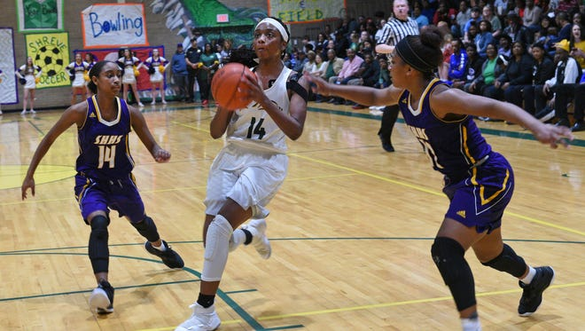 Captain Shreve's Kennedi Heard drives to the hoop against Sam Houston in their playoff game Thursday.