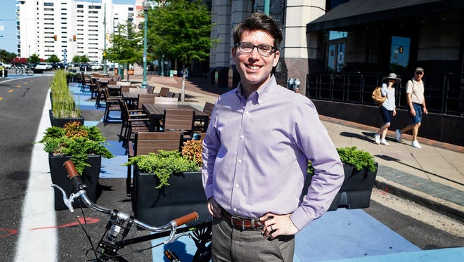 Nicholas Oyler, Memphis' Bikeway and Pedestrian Program manager, stands near a bike lane and plaza area on Peabody Pl. downtown. The improvements implemented by the city with the help of a federal grant has decreased pedestrian accidents in the area.