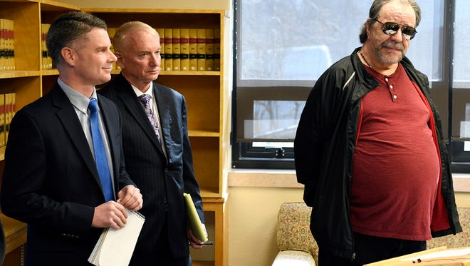 FILE - In this Thursday, April 19, 2018 file photo, Freddie Joe Lawrence, right, one of two men whose convictions were overturned for a 1994 murder, speaks at a press conference with Montana Innocence Project attorneys Toby Cook, left, and Larry Jent in Missoula, Mont. Lawrence and co-defendant Paul Jenkins were convicted in the 1994 death of Donna Meagher, whose body was found west of Helena. Recent DNA tests on a rope found at the murder scene matched another man, a convicted killer. On Friday, June 1, 2018 District Judge Kathy Seeley of Helena dismissed the charges against Lawrence and Jenkins. The state is investigating David Wayne Nelson as a suspect in Meagher's death. (Tom Bauer/The Missoulian via AP, File)