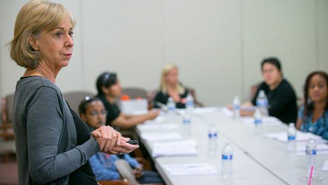Catherine Scrivano teaches a financial seminar at Fresh Start Women's Foundation in Phoenix on April 2, 2015.