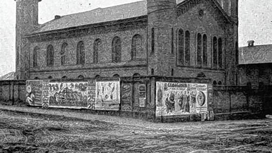 The former arsenal on West Main Street in Columbus -- now the Cultural Arts Center -- is adorned with local circus posters in an 1898 photo.