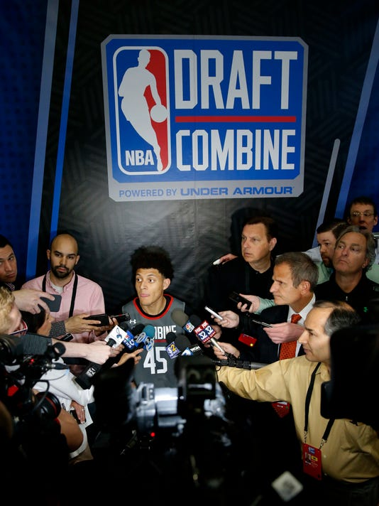 Justin Jackson, center, from North Carolina, listens to a question at the NBA draft basketball combine Thursday, May 11, 2017, in Chicago. (AP Photo/Charles Rex Arbogast)