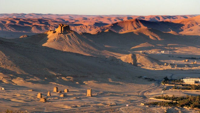 The tower tombs of Palmyra can be seen near the bottom of this aerial view of the ancient city from Jan. 13, 2009.