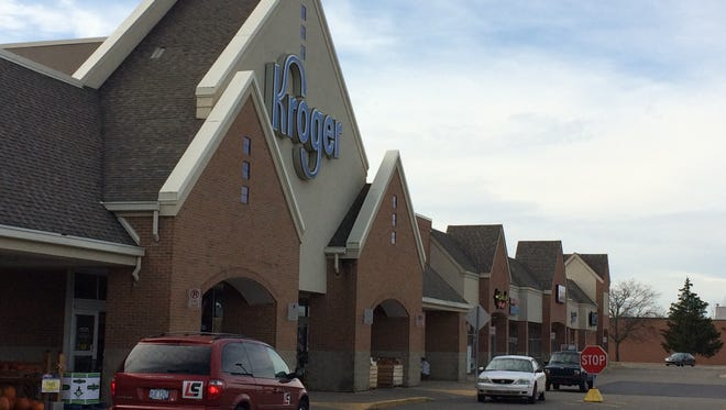 The Kroger store and neighboring shops in Brighton Township.