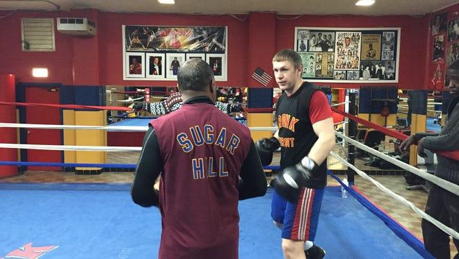 Alexey Zubov with trainer Sugar Hill at Kronk Gym in Detroit.
