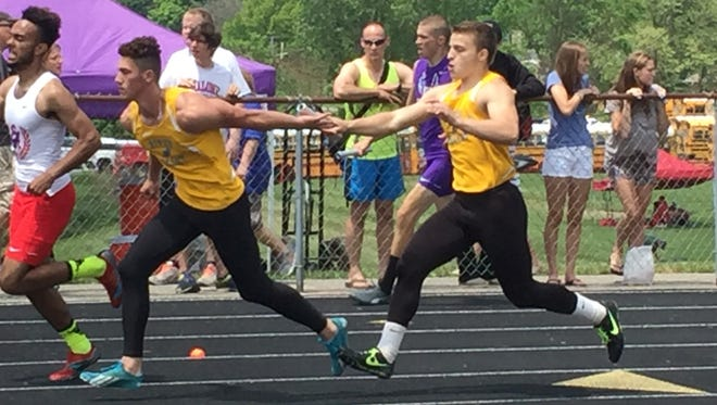 River Valley's Bailey Cole takes the handoff from Tyler Spears during the Division II boys regional 4x200 relay Saturday at Lexington. The Vikings won the race and will compete this weekend at the state meet at Ohio State.