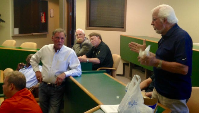 Madison County Commission Chairman Gary Deaton, right, explains a topic during Thursday night's agenda review meeting.