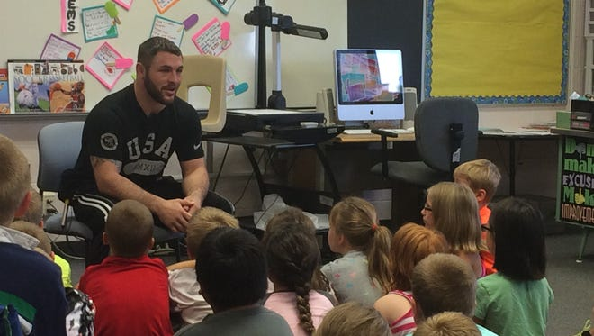 Olympic athlete Ben Provisor, 26, Stevens Point, talks to students at Madison Elementary School.