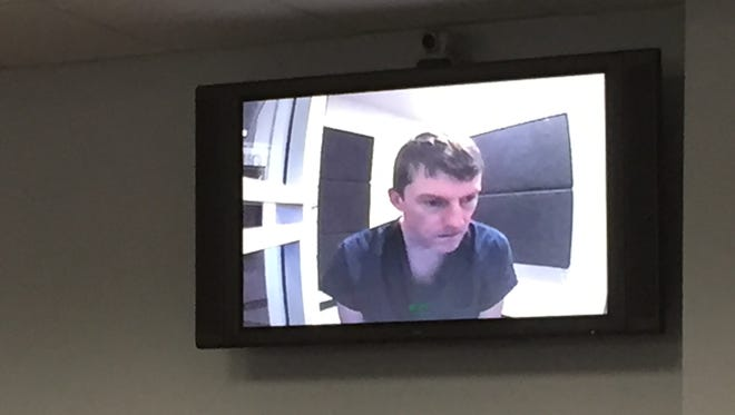 Brian Winchester, 45, appears briefly on a closed-circuit camera feed from the Leon County Jail.