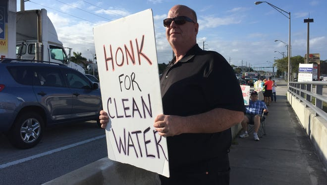 """""""We've been on this bridge since 2013. I support Joe Negron's plan to buy the land, send the water south and save the St. Lucie estuary,"""" said Tony Polito of Stuart, who stands on the Roosevelt Bridge on Tuesday during a rally for clean water in Stuart."""