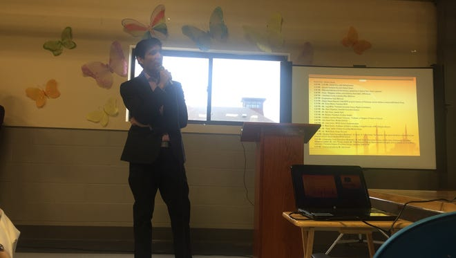Sultan Mokal, the president of the Mid Hudson Islamic Association, speaks at the organization's event Sunday. He spoke about the need for conversations and understanding.