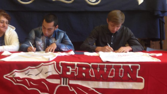 Erwin seniors Genesis Argueta, left, and Mark Marko have signed to play college soccer for Montreat.