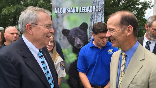 Former Louisiana Department of Wildlife and Fisheries Secretary Robert Barham (left) talks with Theodore Roosevelt IV at an event in 2015 celebrating the removal of the Louisiana black bear from the endangered species list.