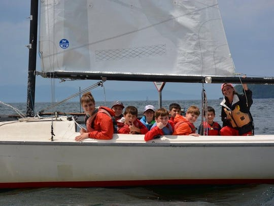 Camper attend a sailing class on a keelboat.
