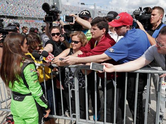 Danica Patrick, front left, talks with members of the media during qualifying for the NASCAR Daytona 500 auto race at Daytona International Speedway, Sunday, Feb. 11, 2018, in Daytona Beach, Fla. (AP Photo/John Raoux)