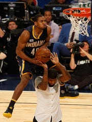 Pacers swingman Glenn Robinson III makes a leap over teammate Paul George during the NBA slam dunk contest Saturday in New Orleans. Robinson won the competition.