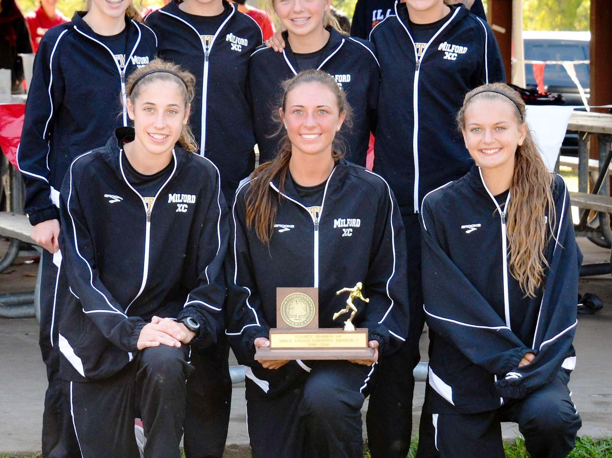 The Milford girls cross country team won the KLAA West title Tuesday over Brighton after finishing runner-up at Oakland County.