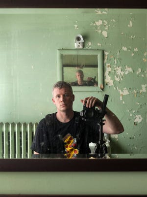 Photographer Steven Bley in one of the abandoned buildings he photographs.