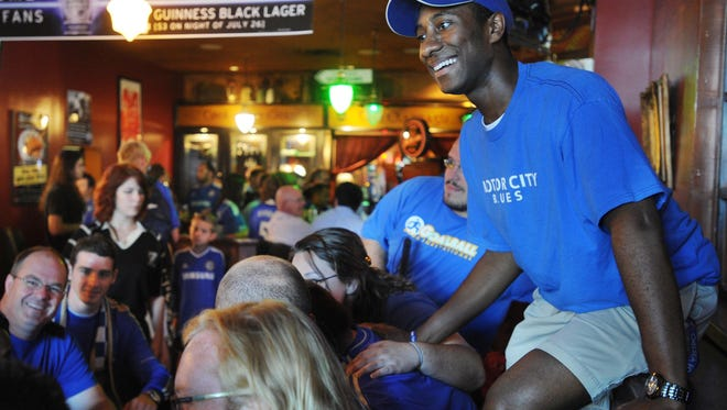 Eddie Bellamy of Royal Oak, Mich., found a high seat in a booth at Claddaugh Irish Pub when he joined Chelsea fans before the start of the Guinness International Championship Cup match between Inter Milan and Chelsea at Lucas Oil Stadium on Aug. 1, 2013.