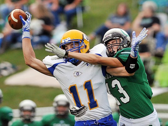 Ontario's Ethan Pensante attempts to catch a pass in a game against Clear Fork.
