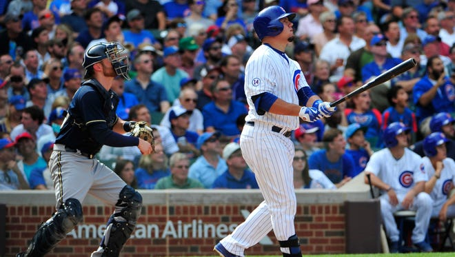 Chicago Cubs' Kyle Schwarber watches his two-run home run against the Milwaukee Brewers during the seventh inning of a baseball game, Thursday, Aug. 13, 2015, in Chicago.