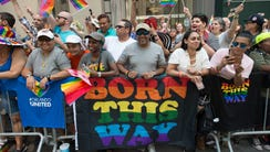 People line the sidewalk during the 46th annual Gay