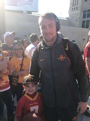 Joel Lanning and his nephew, Emmanuel, share a moment before Iowa State's football game against Kansas this past October.