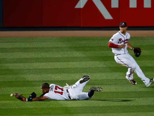 Atlanta Braves center fielder Mallex Smith (17) can't reach a ball hit for an RBI double by Los Angeles Dodgers' Justin Turner in the 10th inning of a baseball game Wednesday, April 20, 2016, in Atlanta. The Dodgers won 5-3 in 10 innings. (AP Photo/John Bazemore)