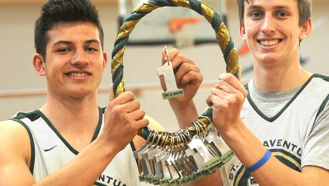 St. Bonaventure High's Kai Rojas, left, and Mikey Hinkle hold the Connection Cord, with each No. 1 representing a team victory. Rojas was named the MVP of the Tri-Valley League while Hinkle was a first-team selection.