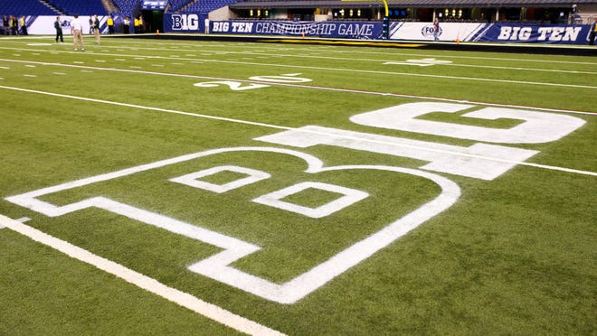 A Big Ten logo is displayed on the field before the Big Ten Conference football championship game between the Iowa Hawkeyes and the Michigan State Spartans at Lucas Oil Stadium.