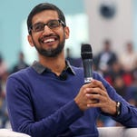 Google Chief Executive Officer Sundar Pichai, smiles during a Q&A with Indian students in New Delhi, India in December. Pichai has received a restricted stock grant from Google worth about $199 million.