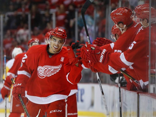 Detroit Red Wings center Andreas Athanasiou (72) celebrates his goal against the Pittsburgh Penguins in the third period of an NHL hockey game Saturday, Jan. 14, 2017, in Detroit.
