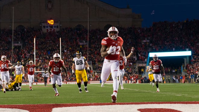 Badgers linebacker Leon Jacobs returns a fumble for a touchdown during the third quarter against the Iowa Hawkeyes at Camp Randall Stadium.