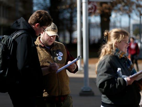 Peter Jensen (center) and Katie Bradley, volunteers