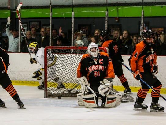 Hartland's Lars Storm (behind net) celebrates a goal