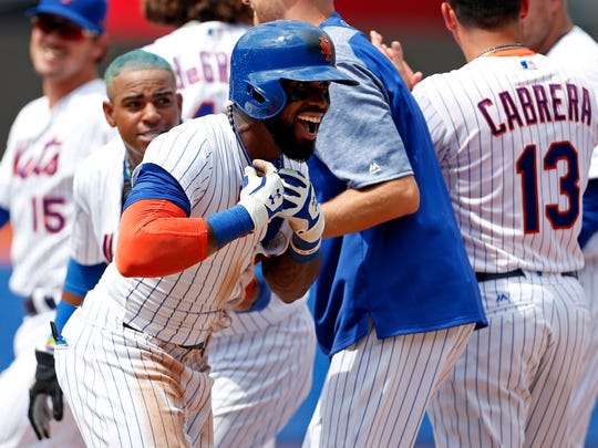 Mets shortstop Jose Reyes (7) celebrates after hitting a walk off single during the ninth inning against the St. Louis Cardinals at Citi Field on Thursday, July 20, 2017.