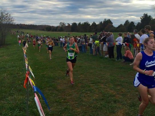 Wilson Memorial's Natalie Prye goes past the 2-kilometer